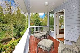 balcony patio furniture balcony house exterior with outdoor furniture and view of woods and river stock balcony outdoor furniture