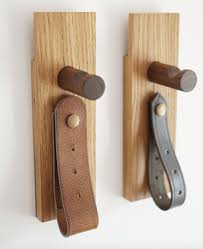 wood and leather coat pegs
