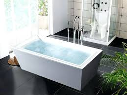 large bathtub with jets freestanding tub with water