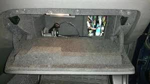 glove compartment fuse box i believe that is how it was my 2009 or 2012 x3 but now it appears to be accessed through a tiny hole in the back of the glove compartment