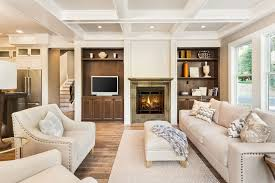 painted living room furniture. The Coffered White Ceiling Is Matched With A Cream-colored Sofa Set Patterned Throw Painted Living Room Furniture