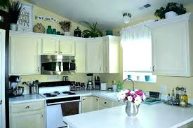 decorating ideas kitchen cabinet tops above cabinet kitchen decor top kitchen cabinet decor storage above kitchen