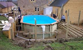 wooden pool installation with decking