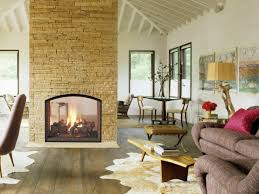 fireplace design two sided living room fur rugs stone wall