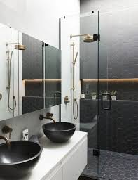 black hexagon tiles on the wall and floor in the shower to make the shower stand