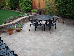 Stone Exterior Patio Flooring Options With Round Table Black Iron Chairs  And Two Decorative Plants