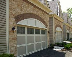 beige garage door with white trim
