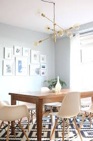 mid century modern dining room with west elm mobile chandelier on dining room light