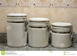best three white ceramic jars on kitchen counter royalty stock pictures tj56