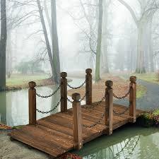 classic wooden garden bridge with metal