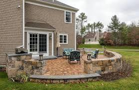 backyard raised stone patio with small wall and outdoor lighting backyard ideas59 backyard