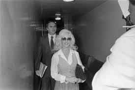 Priscilla Davis arrives with one of her attorneys, Jerry Lofton | UTA  Libraries Digital Gallery