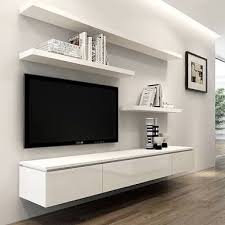 LIKE: wall mounted TV, floating entertainment unit (to keep things hidden  but accessible) and floating shelves for decorations.