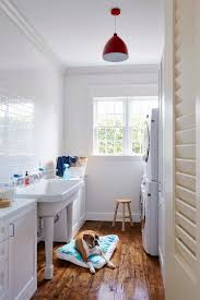 utility room lighting. Diy Utility Sink Laundry Room Beach Style With Red Pendant Light  Louvered Door Lighting