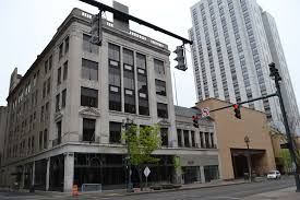 the hilton hotel chain is strongly considering adapting this five story former national clothing