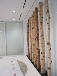 Birch poles and black pebble stones on both sides for an entry way or  hallway in