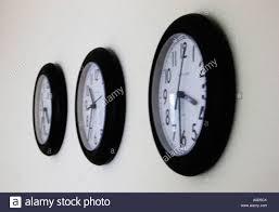 office wall clocks. Three Office Wall Clocks Set At Different Times D