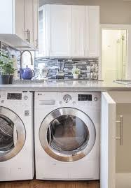 laundry machines under kitchen counter behind doors