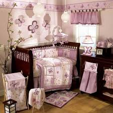 baby girl nursery ideas purple pink ruffle wooden platform