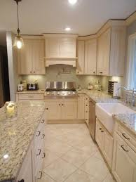 designer s notes when designing a small kitchen use bigger tiles for the floor and turn them on a diagonal to make the room feel larger