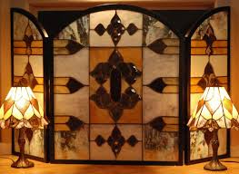unique stained glass fireplace screen in brown touches enlightened by table lamps at contemporary house interior schemes for your fireplace inspiration