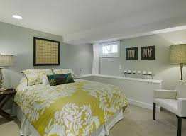 View in gallery Basement bedroom with a simple color scheme
