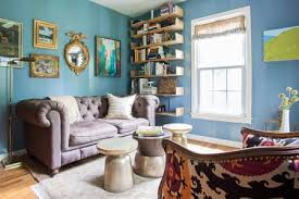 living room with blue walls covered with shelves and artwork
