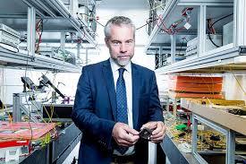 diffusion science radio professor benjamin eggleton holding a photonic chip inside the sydney nanoscience hub laboratory image credit