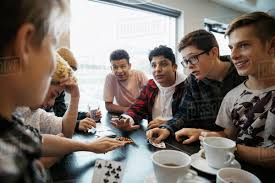 drinking coffee with friends. Interesting Friends Tween Boy Friends Playing Cards And Drinking Coffee At Cafe Table Intended Drinking Coffee With Friends N