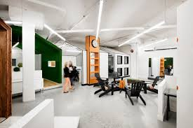 Office offbeat interior design Cardboard Wanting To Rethink How Offices Have Typically Been Laid Out De Lessard Reimagined The Office As Stylized Offbeat Village With The Archetype Of Small Theblogjointcom Space Retail Design Blog