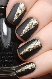 black and glitter gold nail art design gives your matte black nails some atude by adding v shaped glitter gold polish in the middle