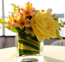 pink and yellow flowers are inviting centerpiece ideas for welcoming table  decor