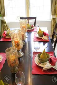 dining table candle holder. dining table setting with candle holders glasses and bowls stock photo - 1728358 holder
