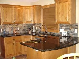 oak kitchen cabinets honey oak kitchen cabinets with black pearl or granite kitchen backsplash with oak