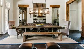 dining room rustic rectangular chandelier over wooden rectangular dining table and 2 wingback dining chairs