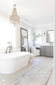 cream beaded chandelier over bathtub