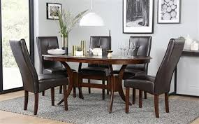 townhouse oval dark wood extending dining table with 4 logan brown chairs