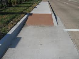 the bottom 24 of the curb ramp must have the truncated domes and the contrasting color