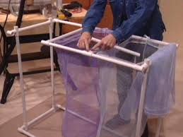 Diy laundry sorter Industrial Laundry Assemble The Separators Diy Network How To Build Pvc Laundry Rack Howtos Diy