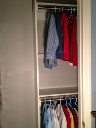 this picture shows the right side of the closet with the upper and lower closet rods there is an upper shelf and middle shelf