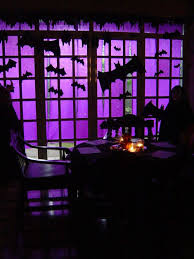 love halloween window decor: use purple crepe paper to cover a large window or glass door and then cut