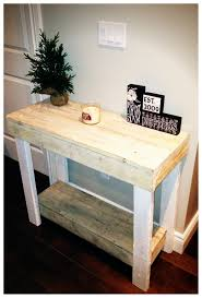 small diy console table made from reclaimed wood for narrow hallway spaces with storage and painted with white color decor ideas