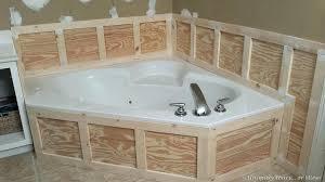 tile trim around bathtub installing wainscoting in master bathroom glass surround kit
