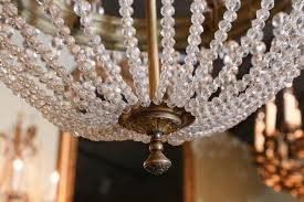 large french empire style bronze and crystal chandelier with six lights in good condition for