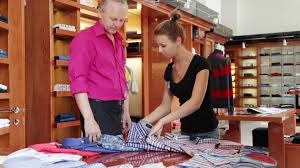 man talking s assistant in clothes shop footage  a still