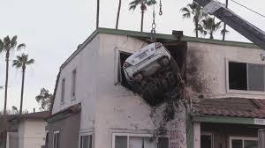 car crashes into balcony ile ilgili görsel sonucu