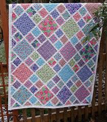 Best 25+ Layer cake quilts ideas on Pinterest | Layer cake quilt ... & LAYER CAKE QUILT - Fun design that could showcase prints in the larger  square. This link goes to an Etsy shop that sold this quilt. Pattern would  be easy to ... Adamdwight.com