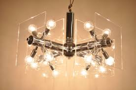 remarkable vintage lucite and chrome sputnik chandelier this fantastic light fixture features a mirror finished