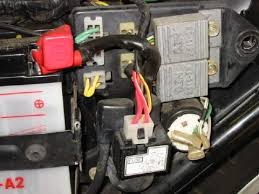 ignition problems the kill switch a timing pickup coil assembly located at the rear of the crankshaft and two ignition coils plug wires spark plugs