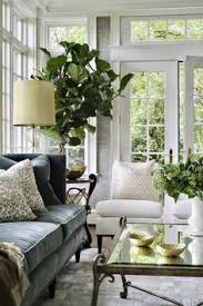 love the wallpaper windows and trim dark grey elves couch white slipper chairs sea grass wallpaper fiddle leaf on wall decor for traditional living room with 35 attractive living room design ideas pinterest living room